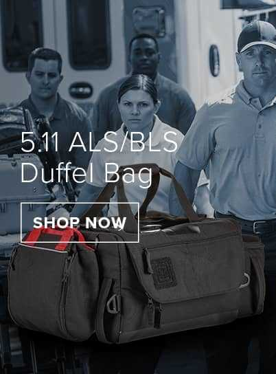 Emergency service professionals in front of a ambulance. Infront is a black 5.11 ALS/BLS Duffel Bag