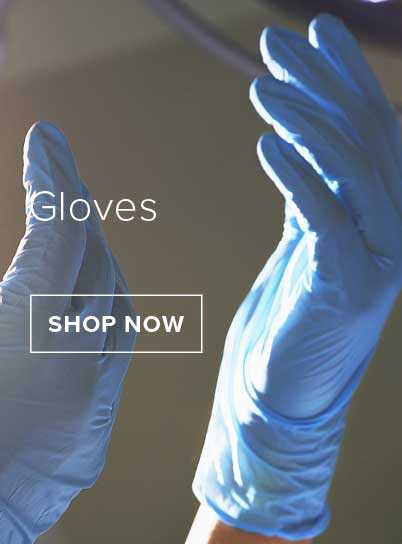 Two hands held up in the air wearing blue medical disposable gloves.