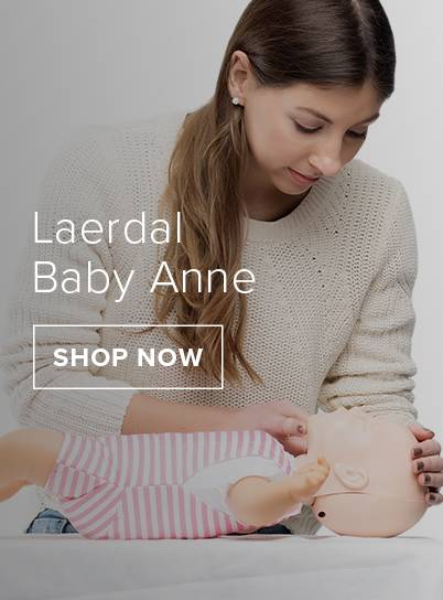A female leaning over a laerdal baby anne.